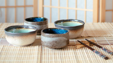 Japanese brown earthen tea cups with blue and torque glaze inside