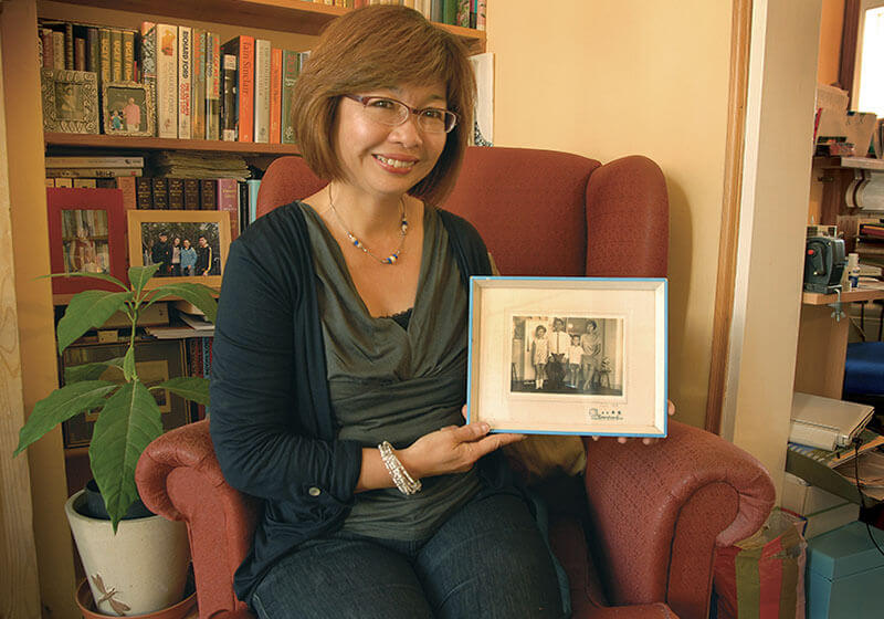 01.	Ms. Christina Mei Yong Chow with her treasured family photo