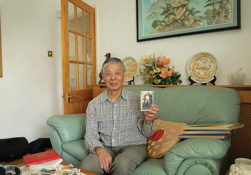 Mr. Yuk Lun Liu with his treasured old family photos
