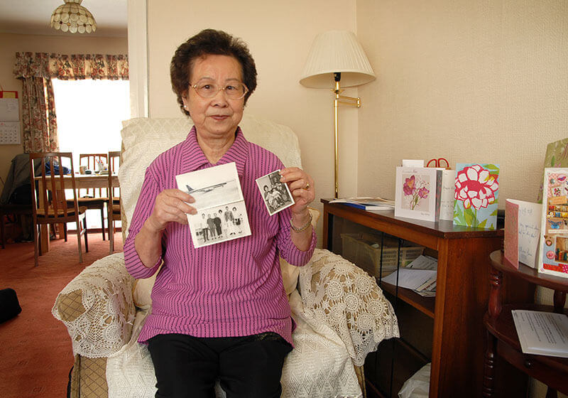 Fung Yiu Lee with her treasured old family photos
