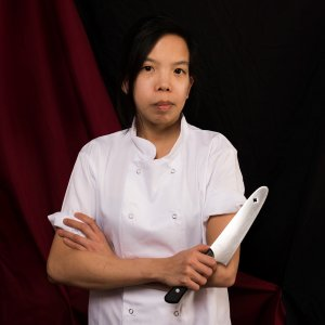 Emily Chan is holding a knife posing in a studio portrait. Photo by Marie-Lisette Cropp